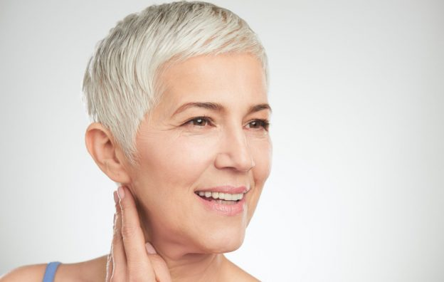 Senior woman hair loss doctor